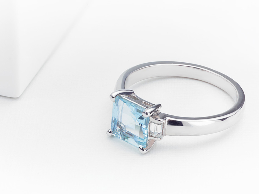 Baguette cut diamond engagement ring with central Aquamarine