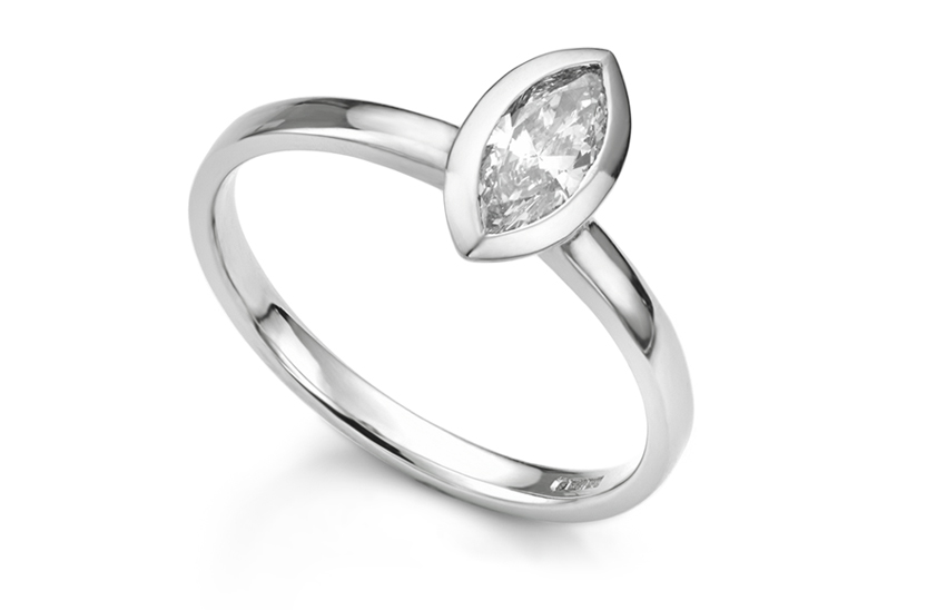 Bezel set Marquise diamond ring. Bezel settings clearly define the shape of the diamond.