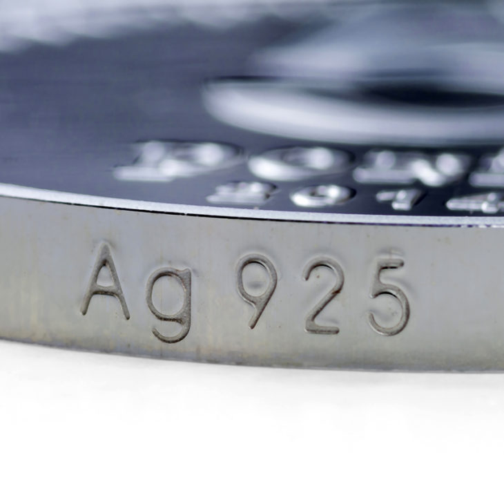 925 Stamp appearing on coin