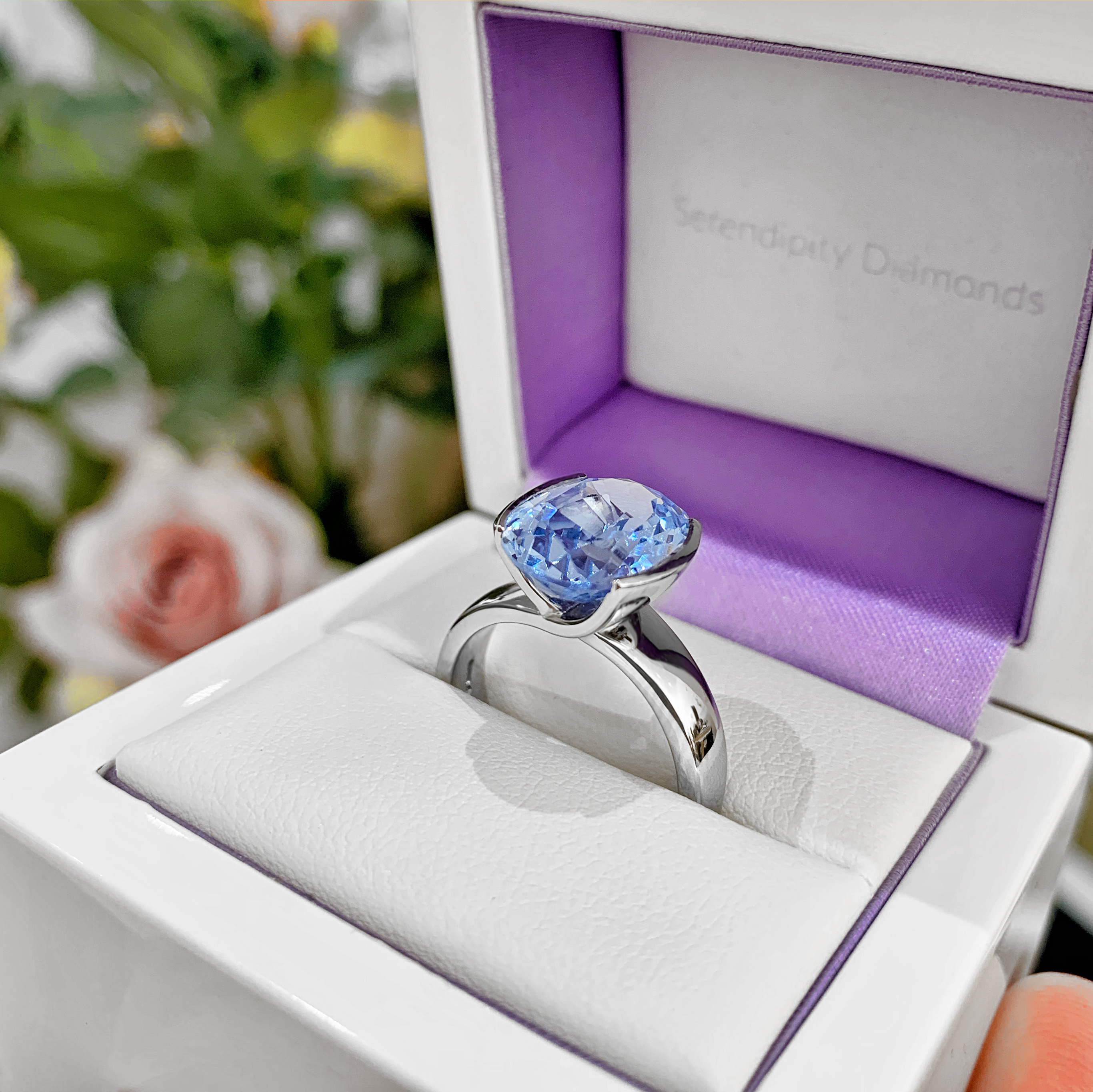 Aquamarine bespoke ring shown boxed before collection
