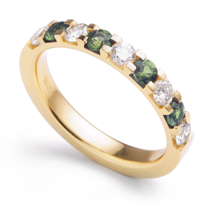 Peridot and diamond claw set eternity ring