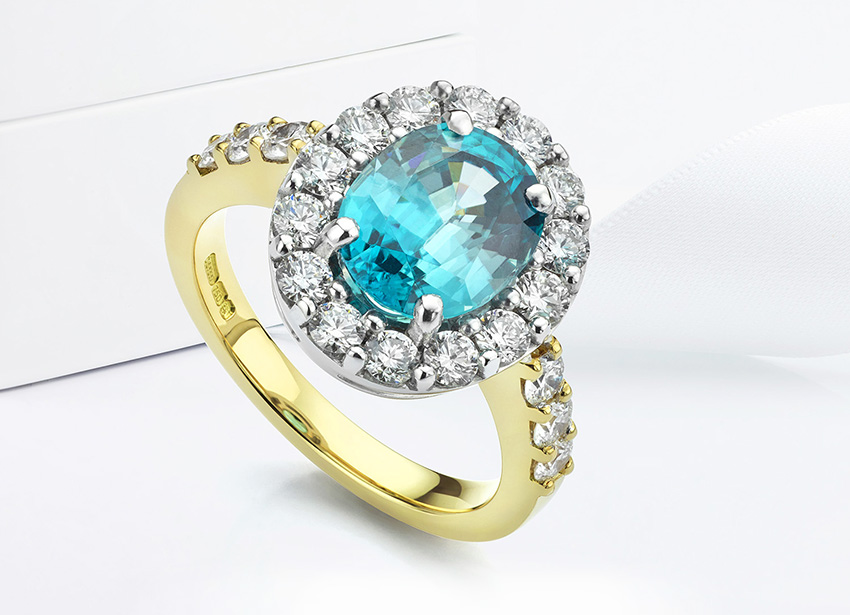 Blue Zircon and diamond cluster ring set into 18ct Yellow Gold