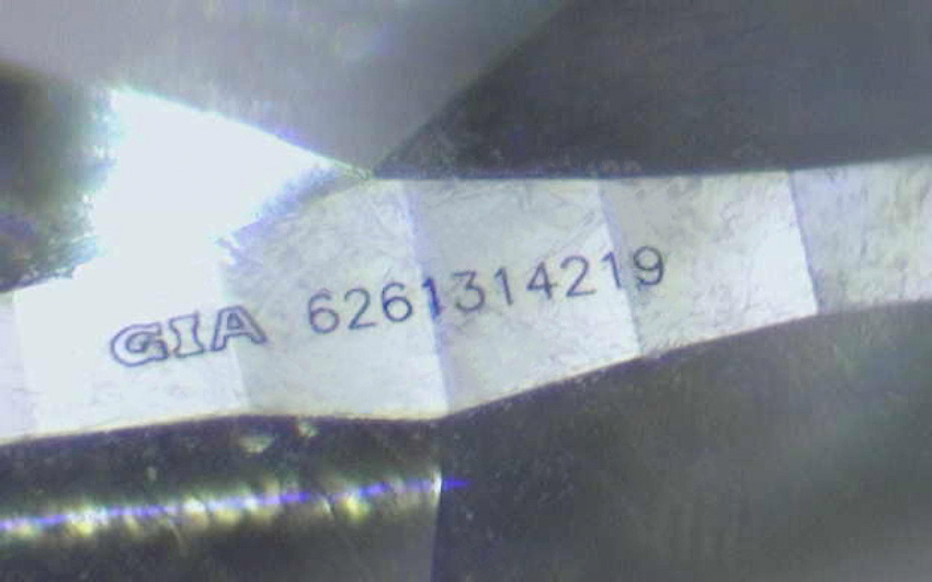 GIA report number viewed under high magnification on the side of a diamond