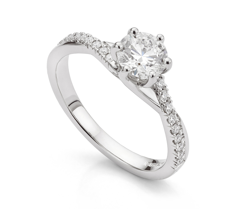 Twisted shoulder engagement ring
