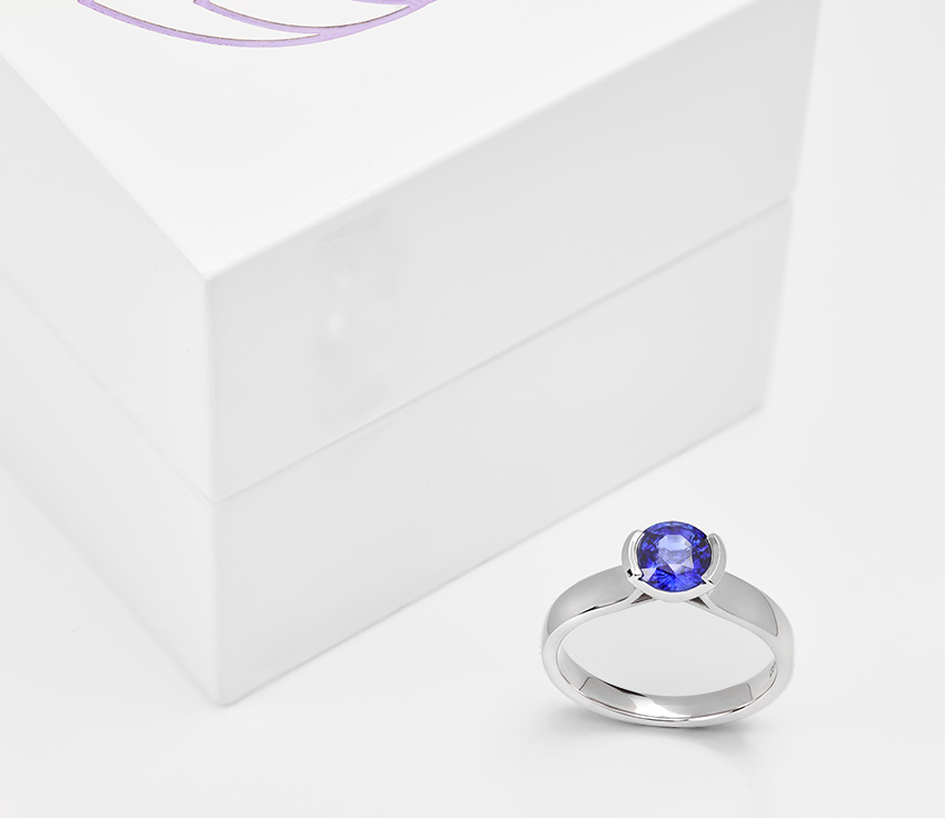 Blue sapphire tension set engagement ring