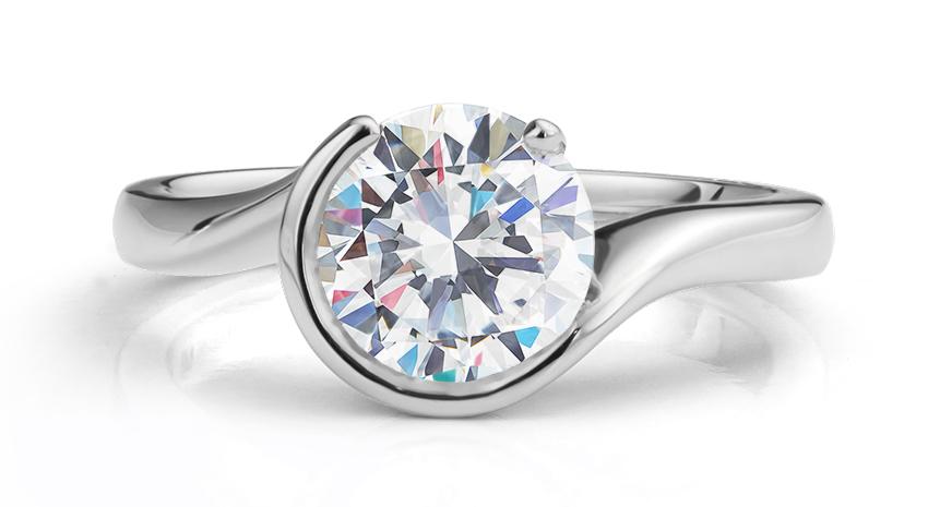 Part-bezel tension set engagement ring