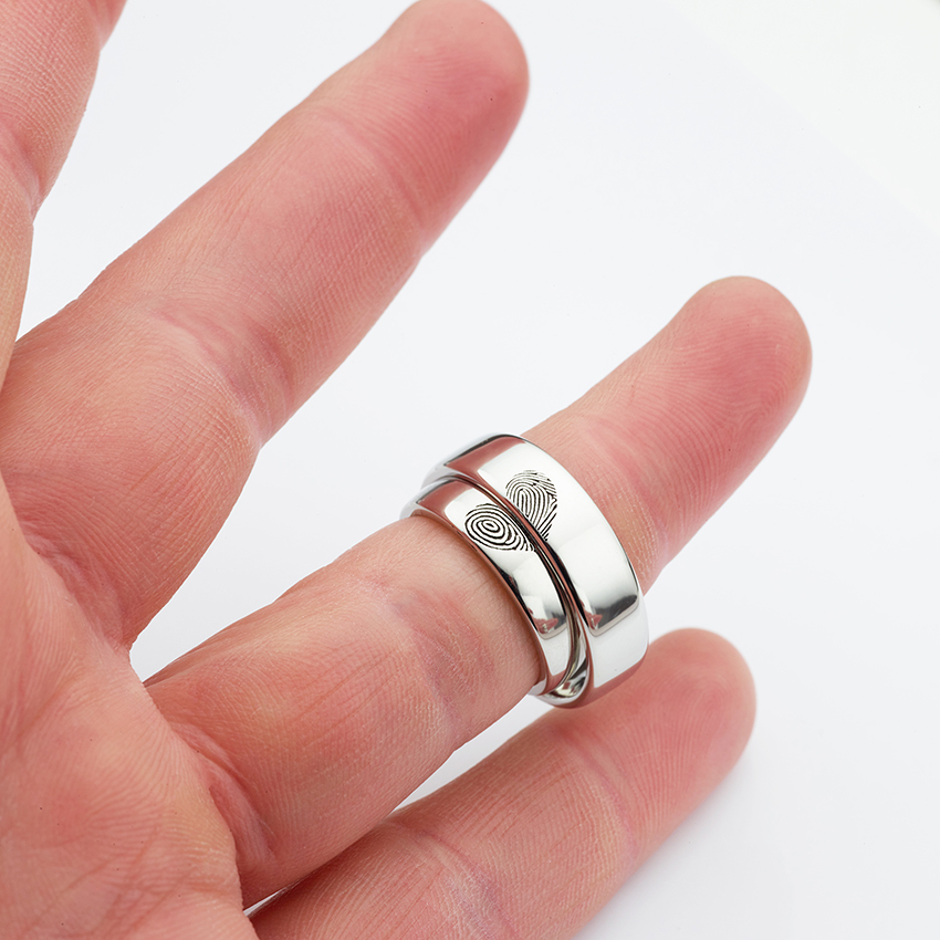 Mens Platinum wedding ring with womens Platinum wedding ring including heart shaped fingerprint engravings