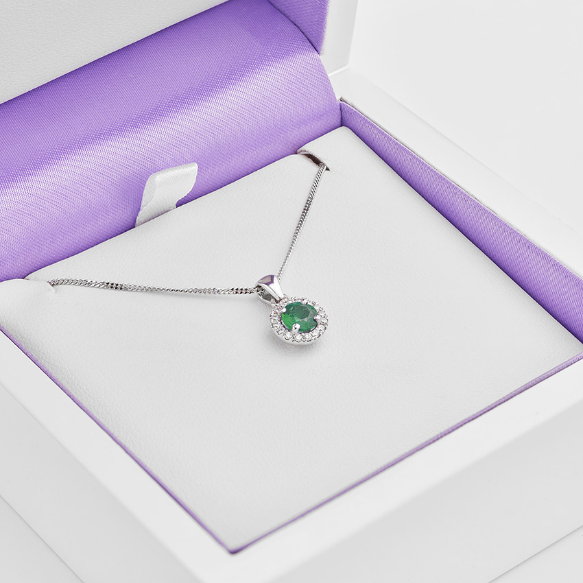 Diamond halo with emerald centre necklace
