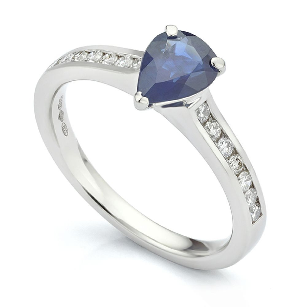 Pear shaped Sapphire solitaire with channel set shoulders