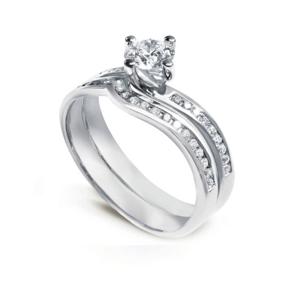 Twist engagement ring with matching wedding ring