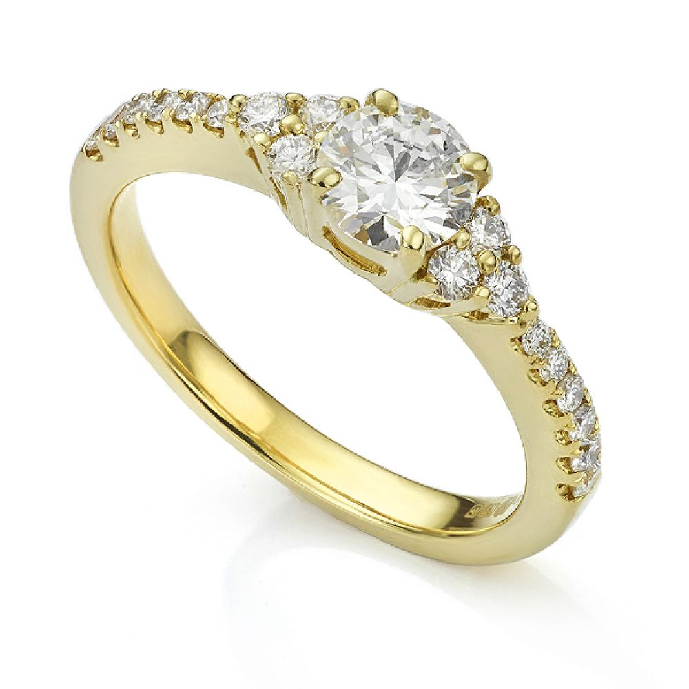 Christie diamond shoulder engagement ring in Yellow Gold