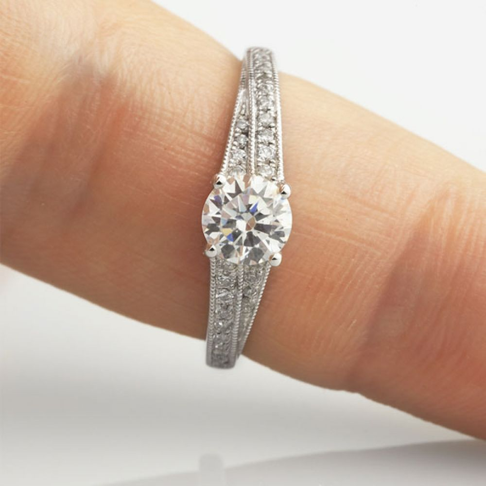 Vintage Diamond Engagement Ring with Stepped Shoulders Shown On Finger