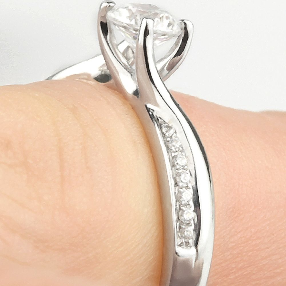 Vintage 4 Claw Twist Ring with Diamond Shoulders Shown On Finger