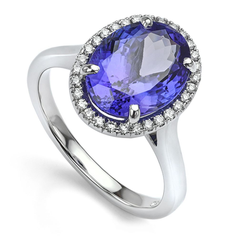 Bespoke 3 Carat Oval Tanzanite diamond halo engagement ring crafted in 18ct White Gold