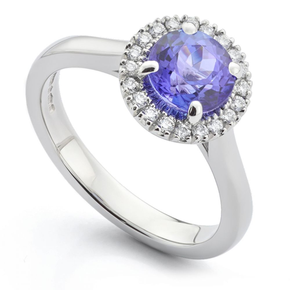 Bespoke round Tanzanite and diamond halo engagement ring