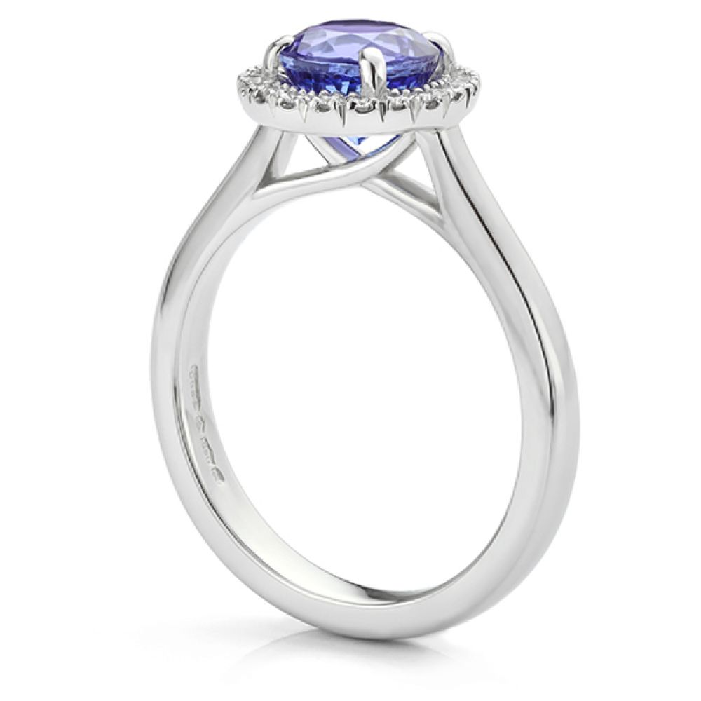 Side view of bespoke tanzanite halo engagement ring