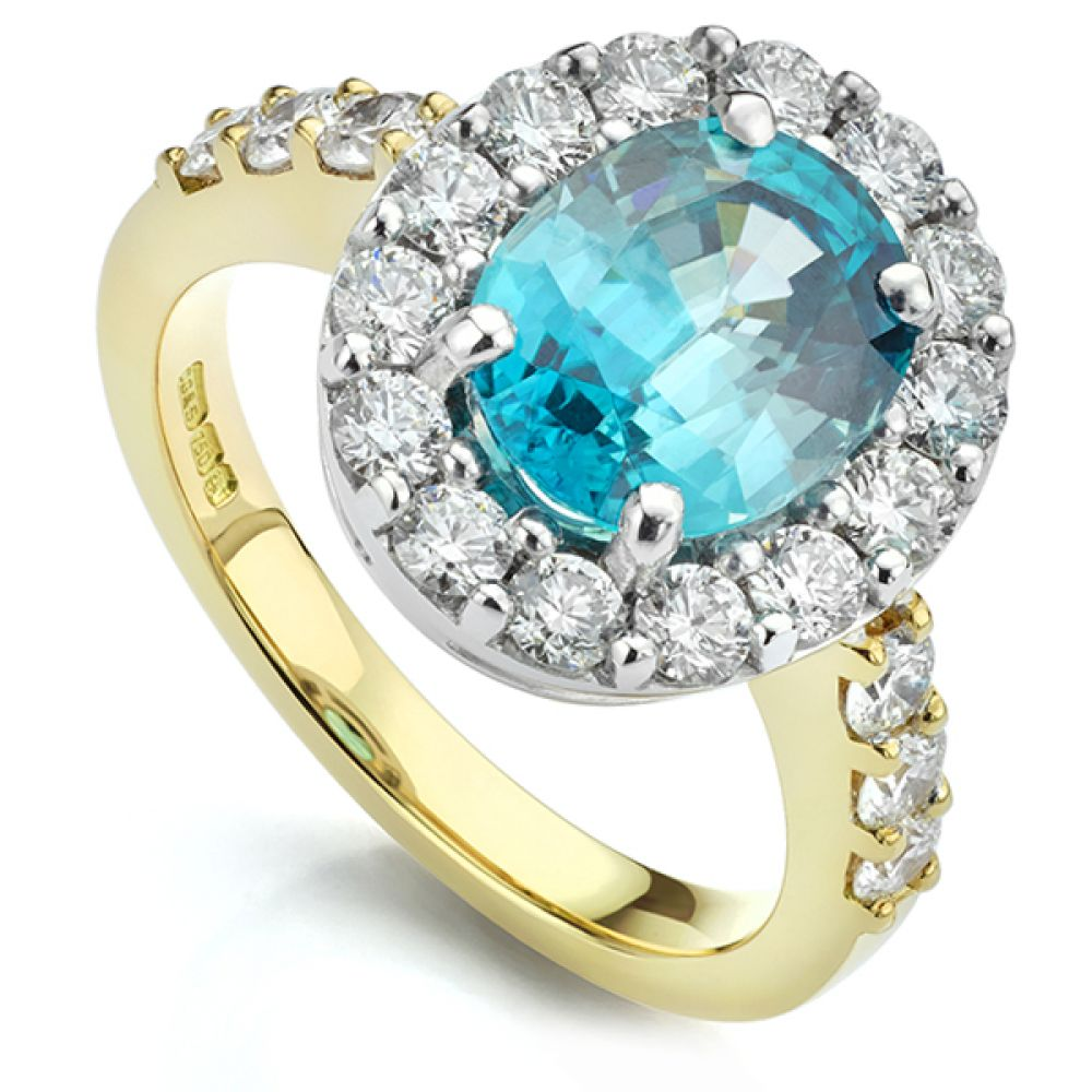 Bespoke Blue Zircon and Diamond Halo Ring in Yellow Gold