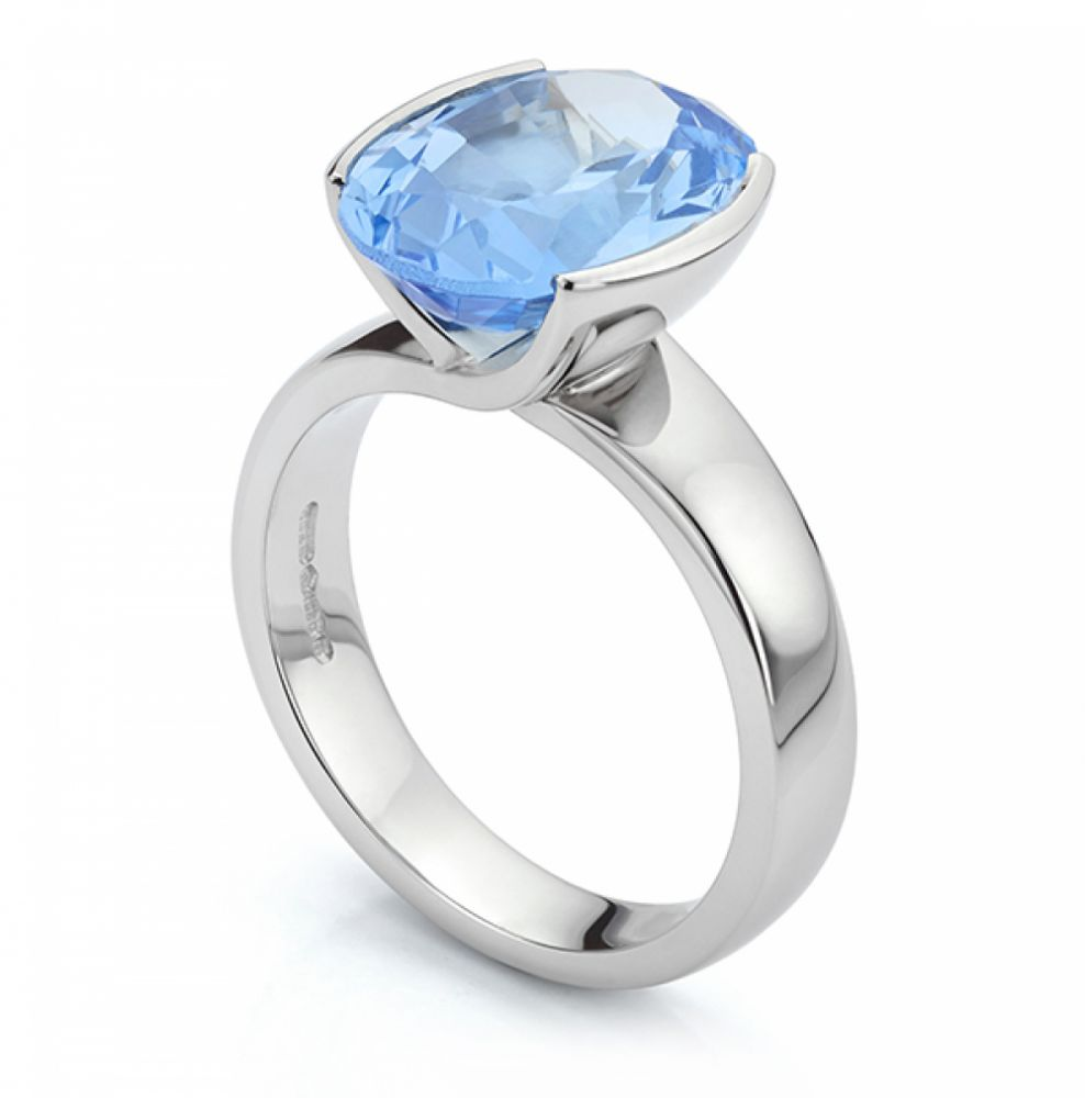 Bespoke tension style Aquamarine ring in Platinum