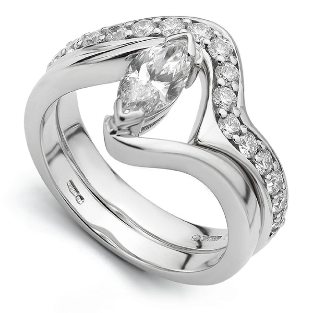 Marquise engagement ring with shaped wedding ring
