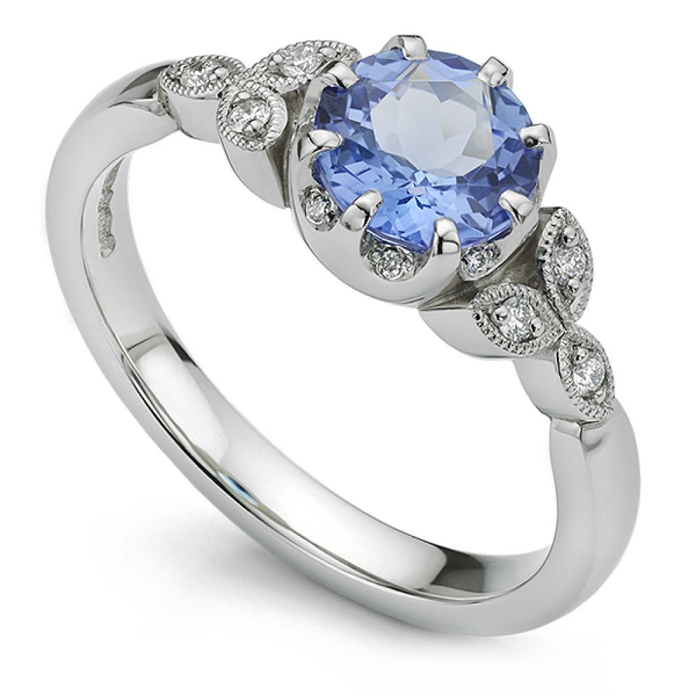 Bespoke Tanzanite Engagement Ring with Diamonds and Vintage style Milgrain set diamond shoulders.