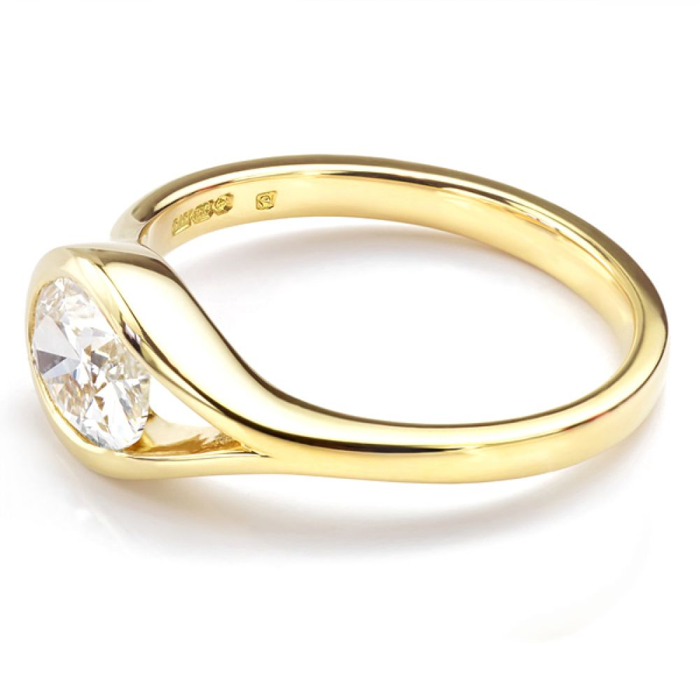 Oval Fairtrade Gold engagement ring side view