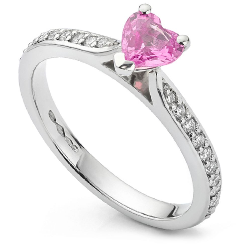 Heart shaped pink sapphire diamond engagement ring with diamond shoulders
