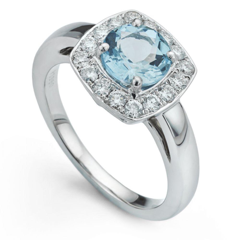 Aquamarine and diamond platinum halo engagement ring
