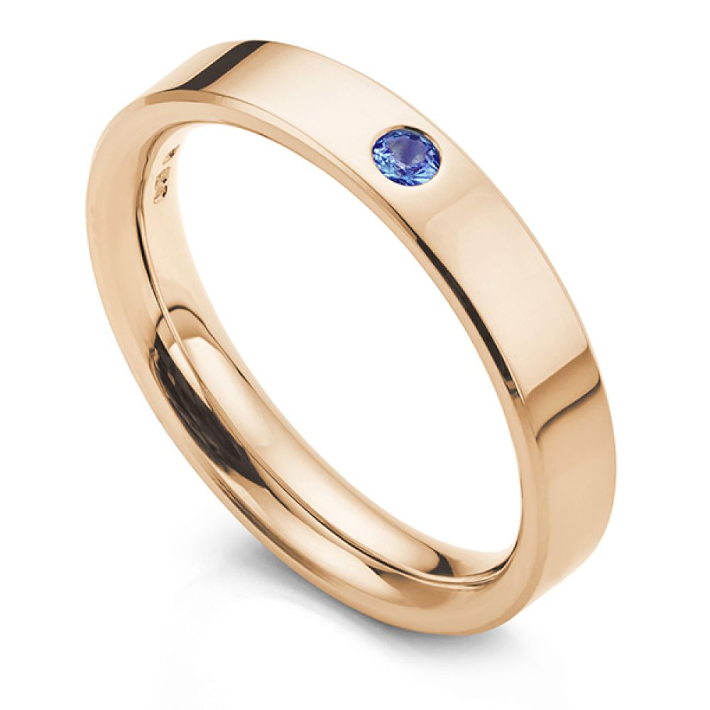 Blue sapphire wedding ring in rose gold