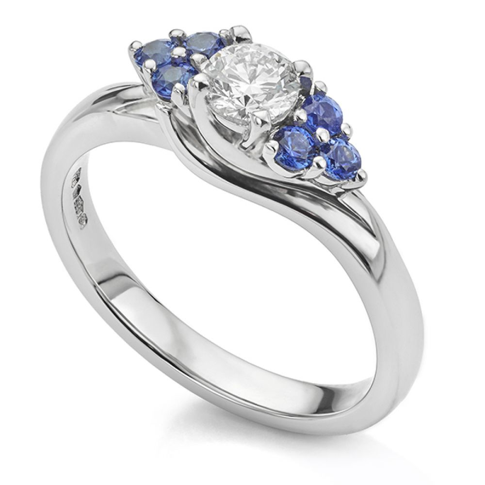 Bespoke blue sapphire and diamond ring perspective view