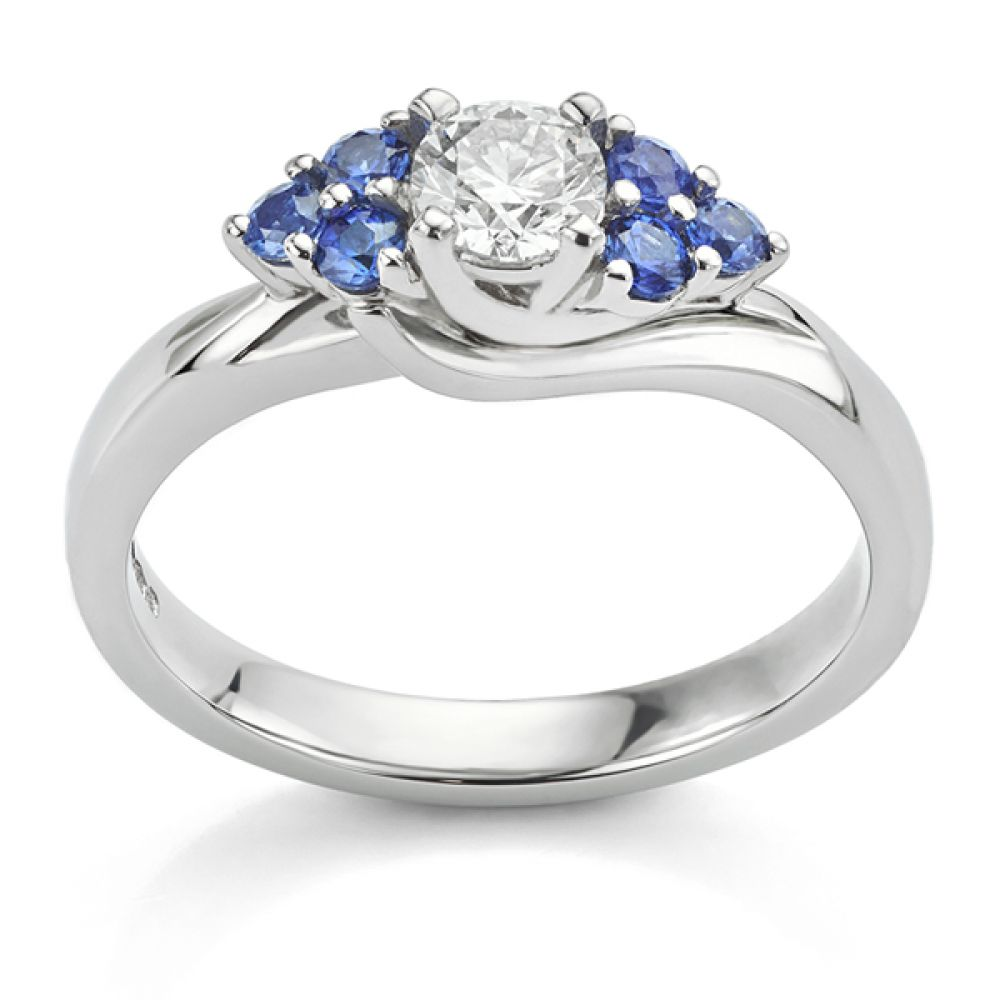 Blue sapphire shoulders in a bespoke diamond ring side view