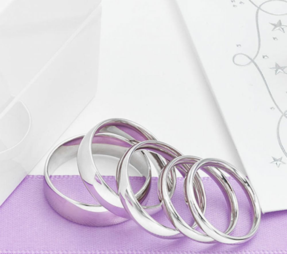 Court shaped wedding bands in various widths