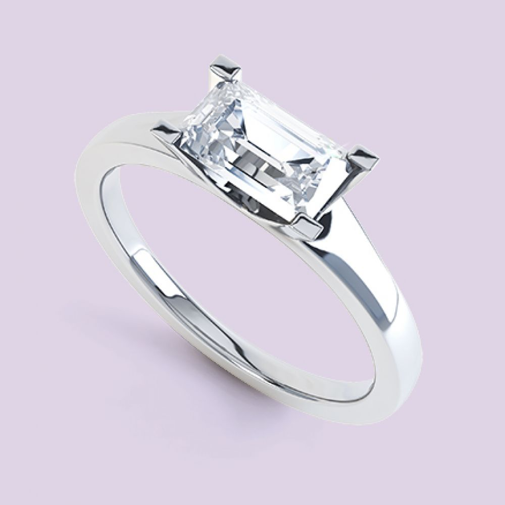 Emerald cut solitaire engagement ring with diamond in the Ice design