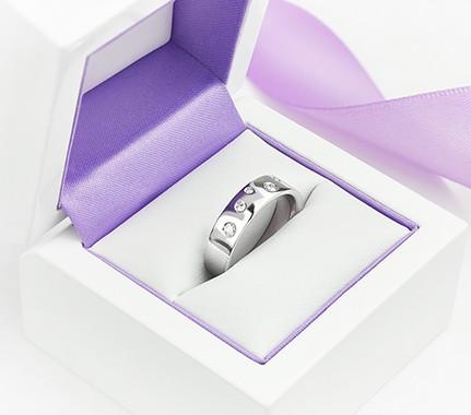 Semi set diamond wedding ring in Platinum with flush set diamonds