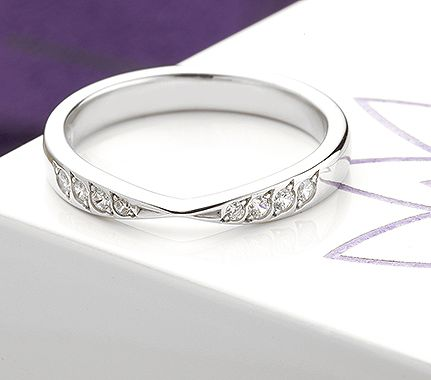 Fitted wedding rings diamond set bowtie design