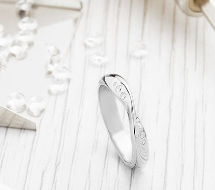 Diamond set fitted wedding ring with flush set diamonds