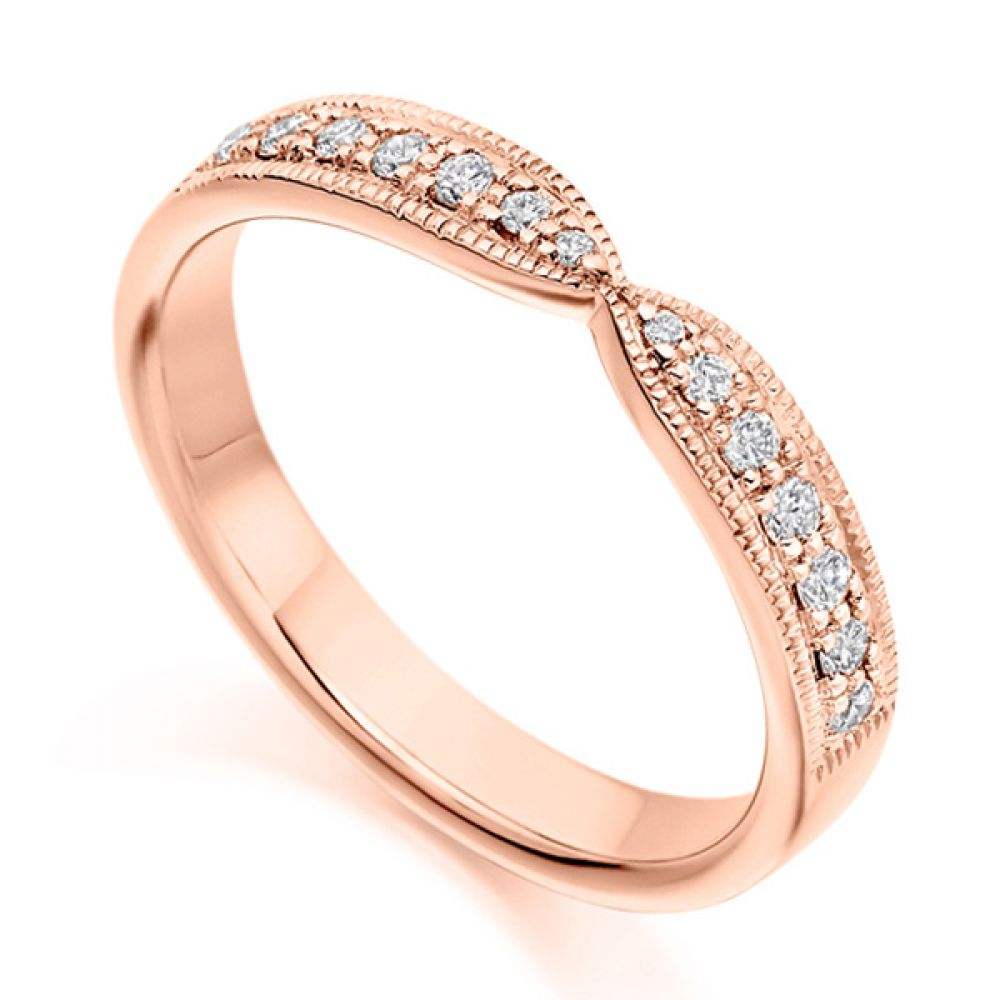 Vintage shaped diamond eternity or wedding ring in rose gold with grain setting and milgrain edge detail