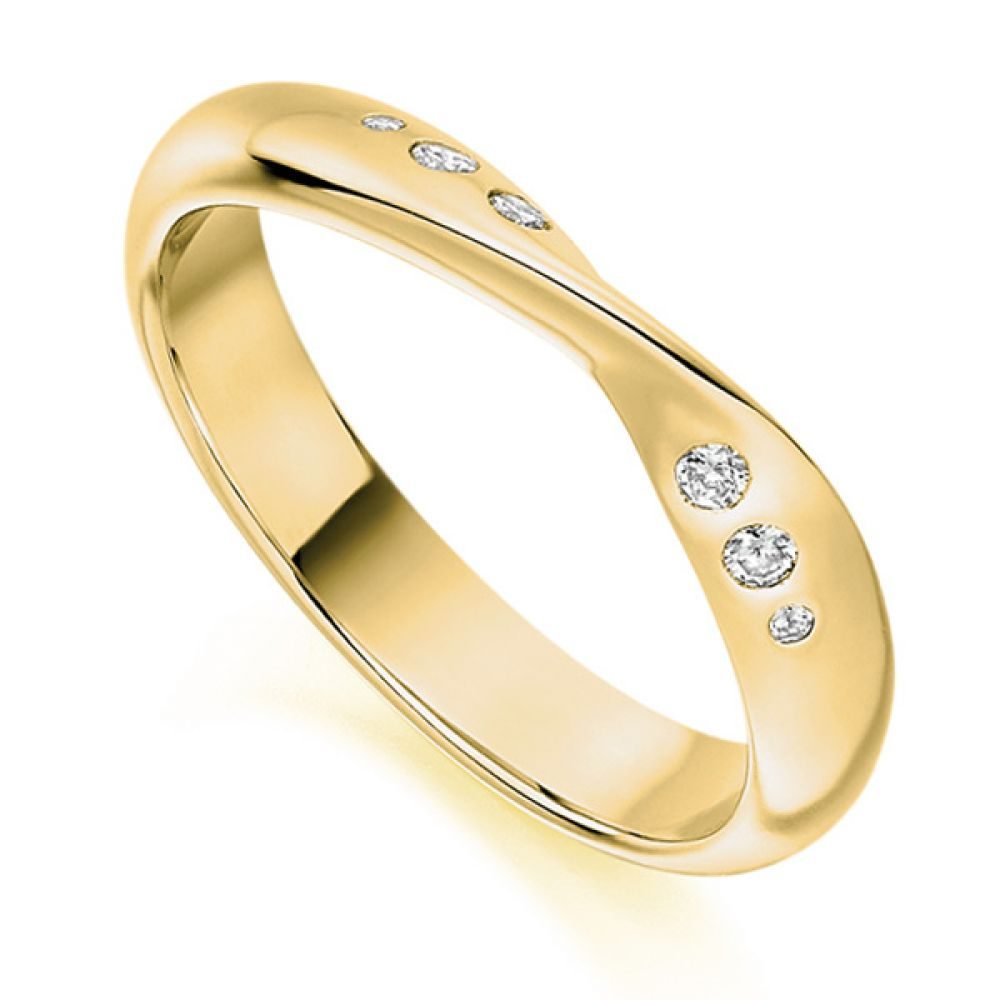 Flush set ribbon twist shaped wedding ring yellow gold