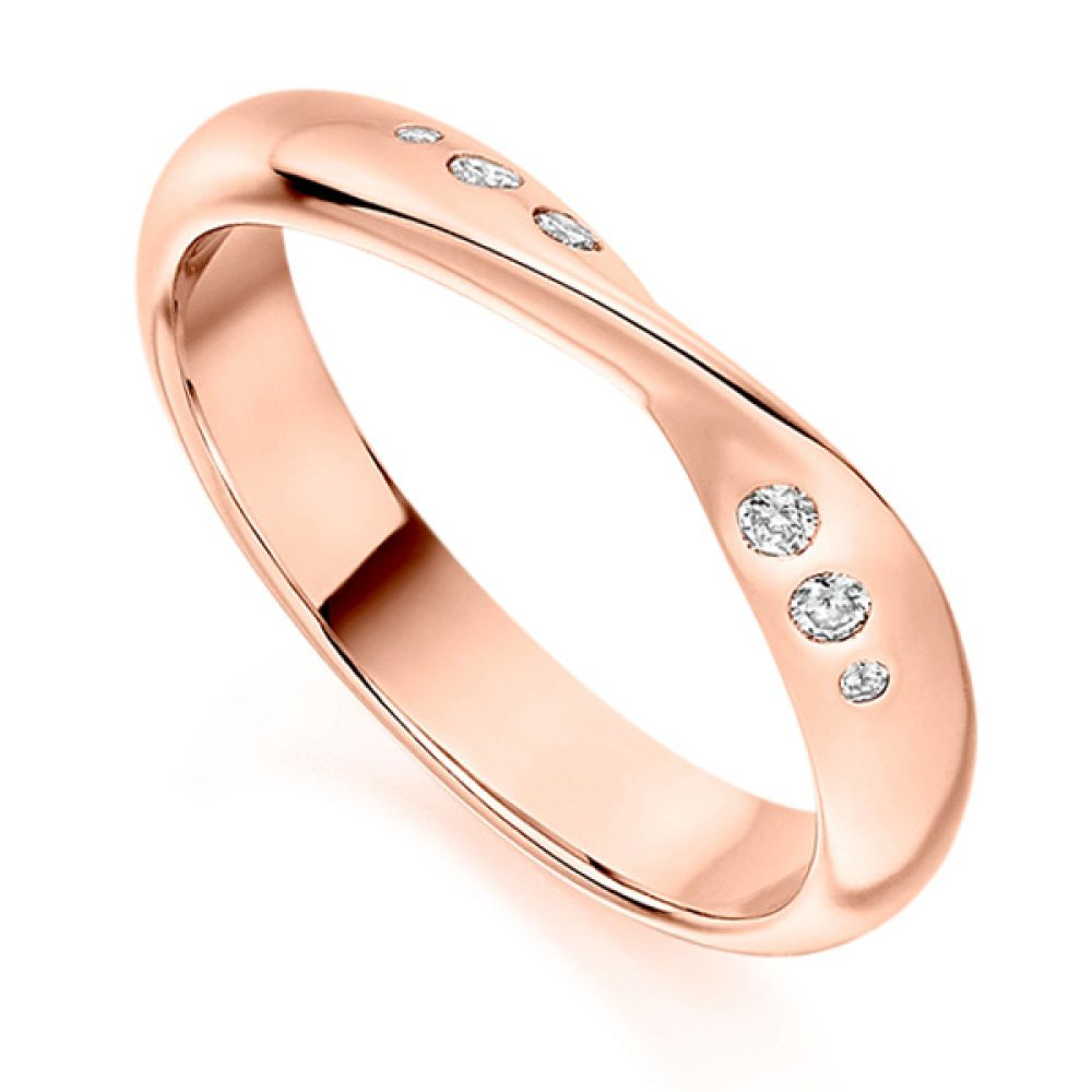 Flush set ribbon twist shaped wedding ring rose gold