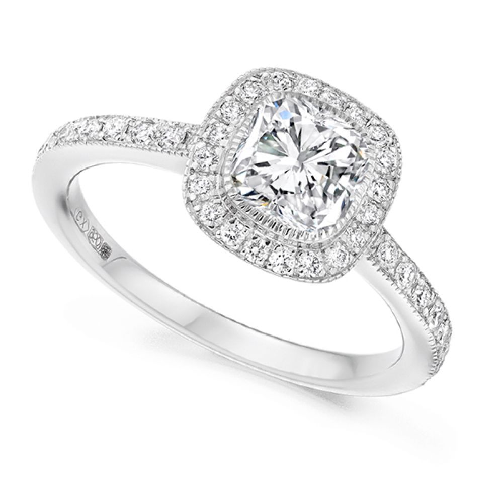 Cushion cut diamond halo engagement ring in white gold