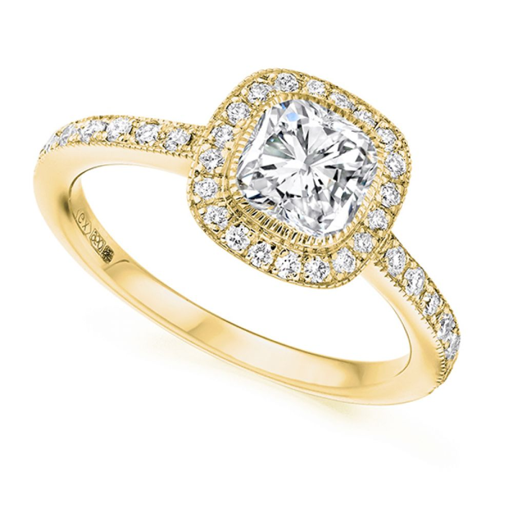 Cushion cut diamond halo engagement ring in yellow gold