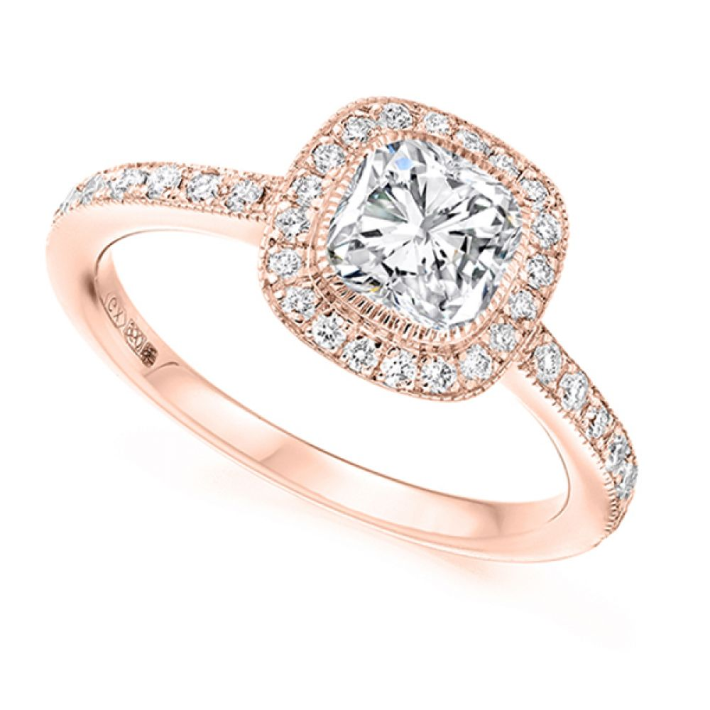 Cushion cut diamond halo engagement ring in rose gold