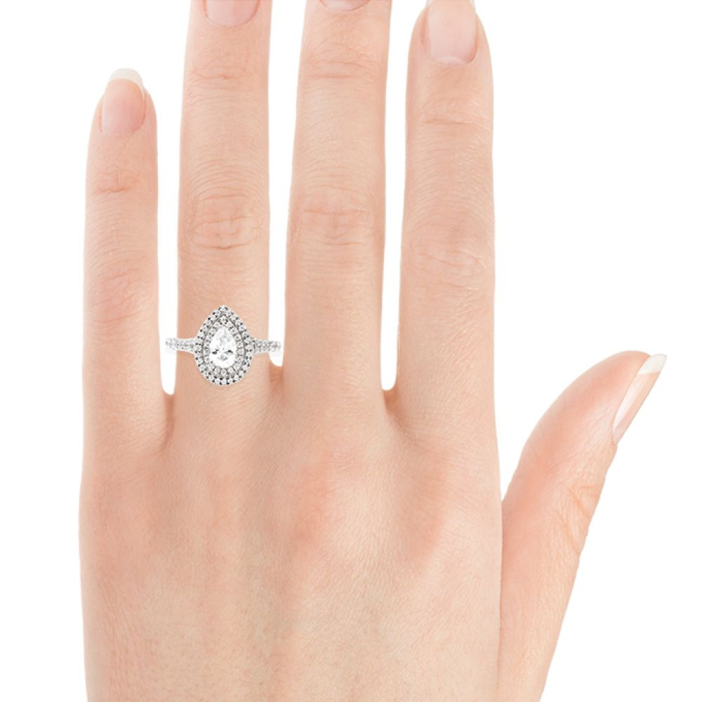 Pear shaped double halo engagement ring on hand