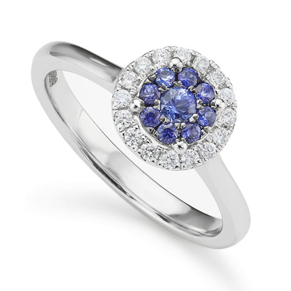 Blue sapphire and diamond halo engagement ring