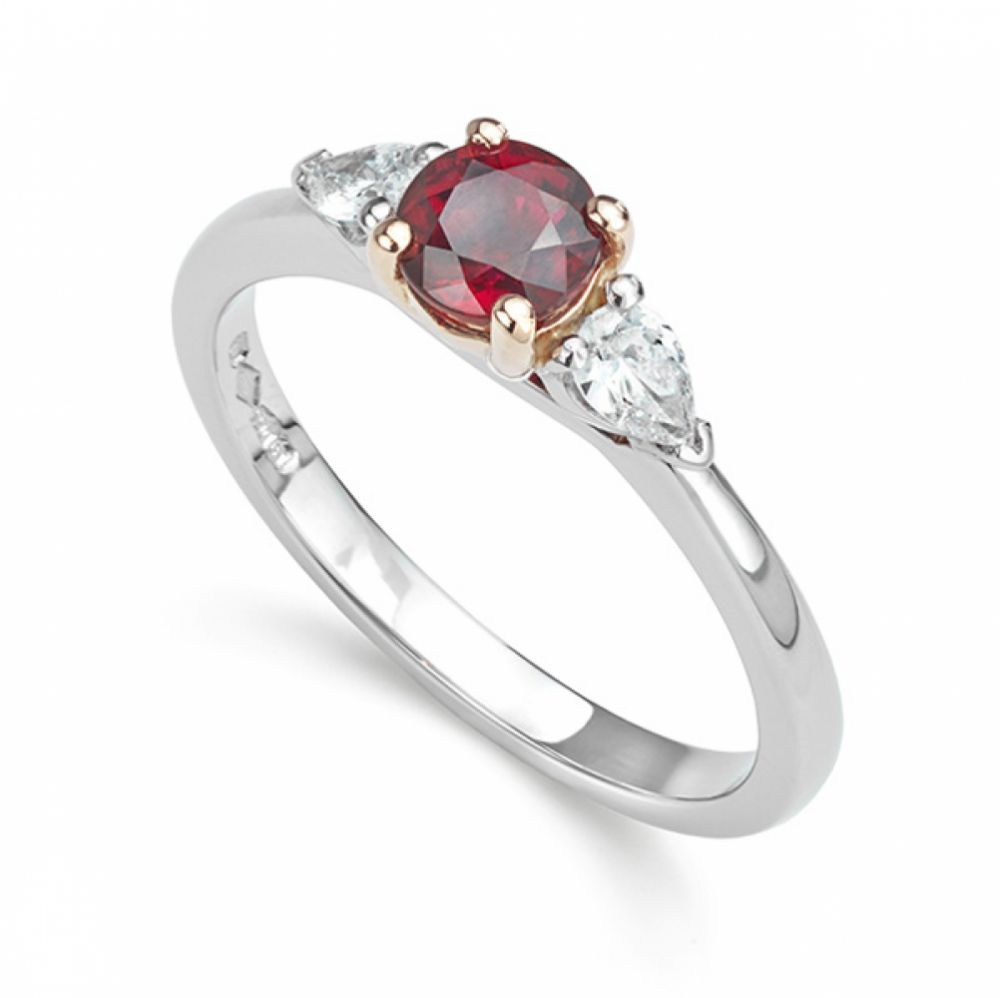 Ruby 3 stone diamond engagement ring with Pear shaped diamond shoulders