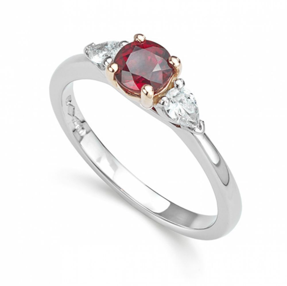 Ruby and pear shaped diamond 3 stone ring