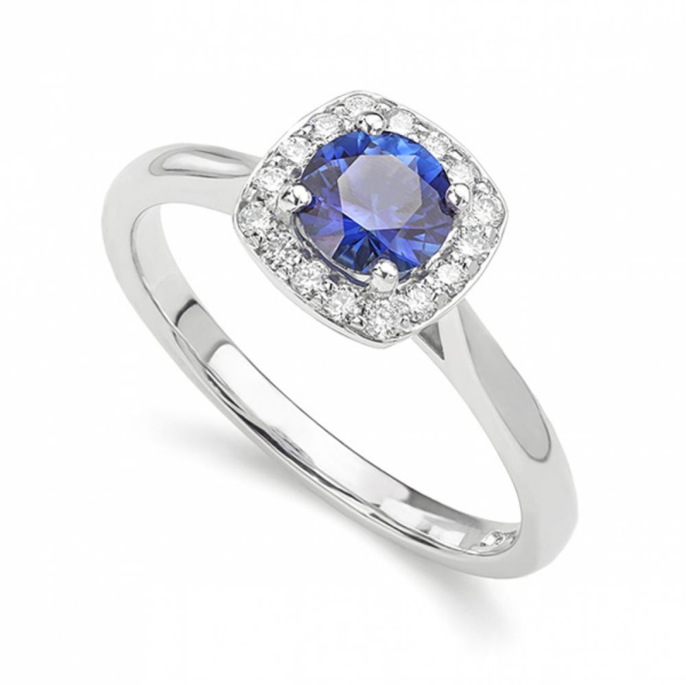 Royal blue sapphire and diamond cushion halo engagement ring perspective view