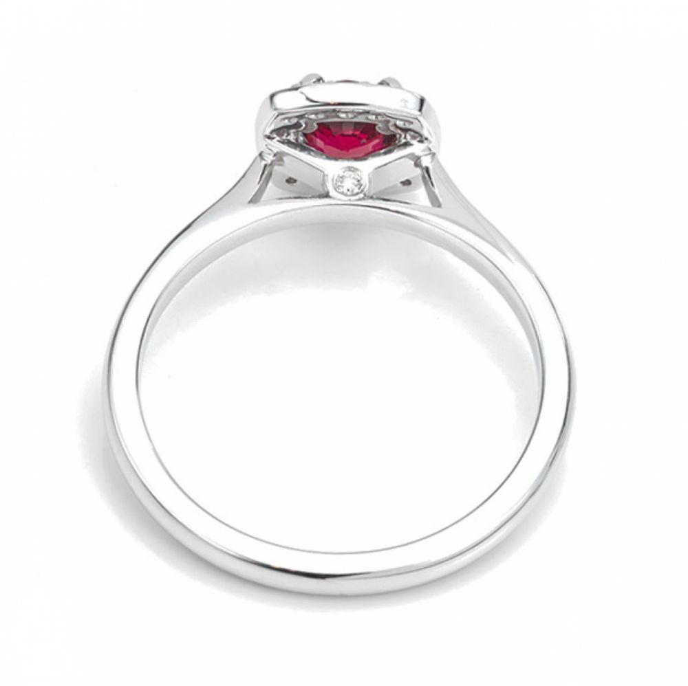 Red ruby and diamond halo engagement ring side view