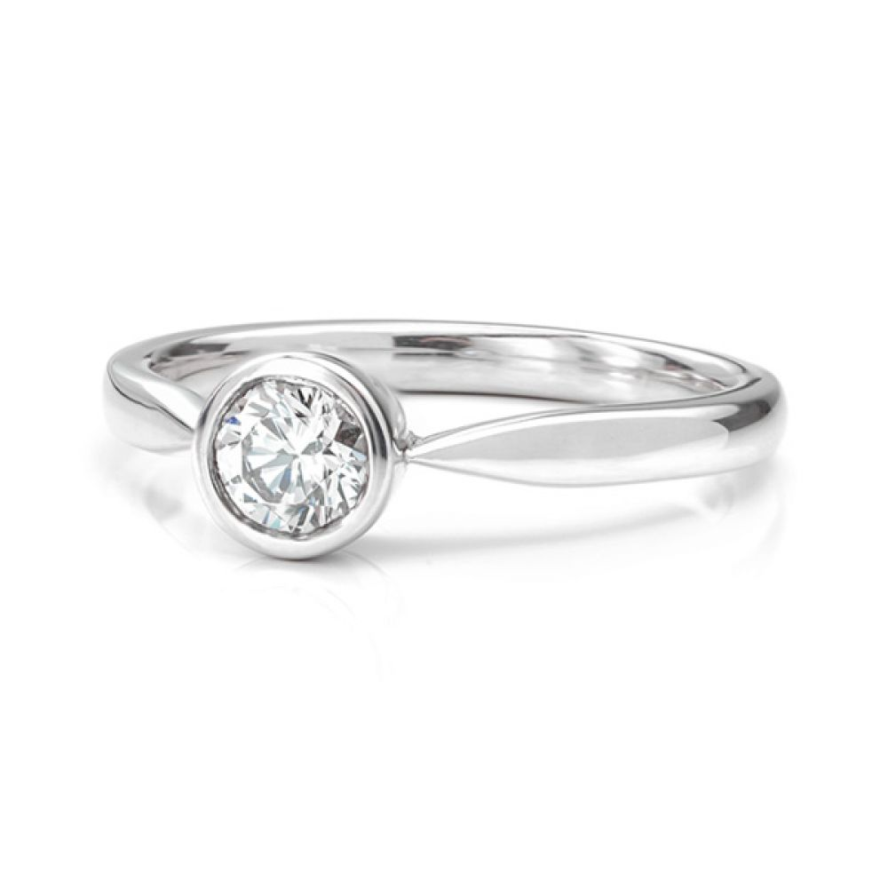 Olivia rub-over diamond solitaire engagement ring white gold lying down view