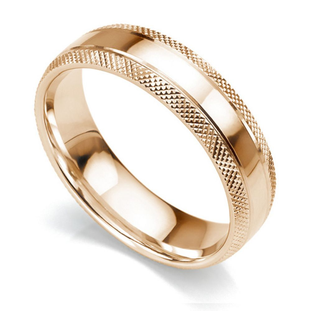 6mm court shaped wedding ring with edges cross-hatch patterned either side of a central polished section in rose gold