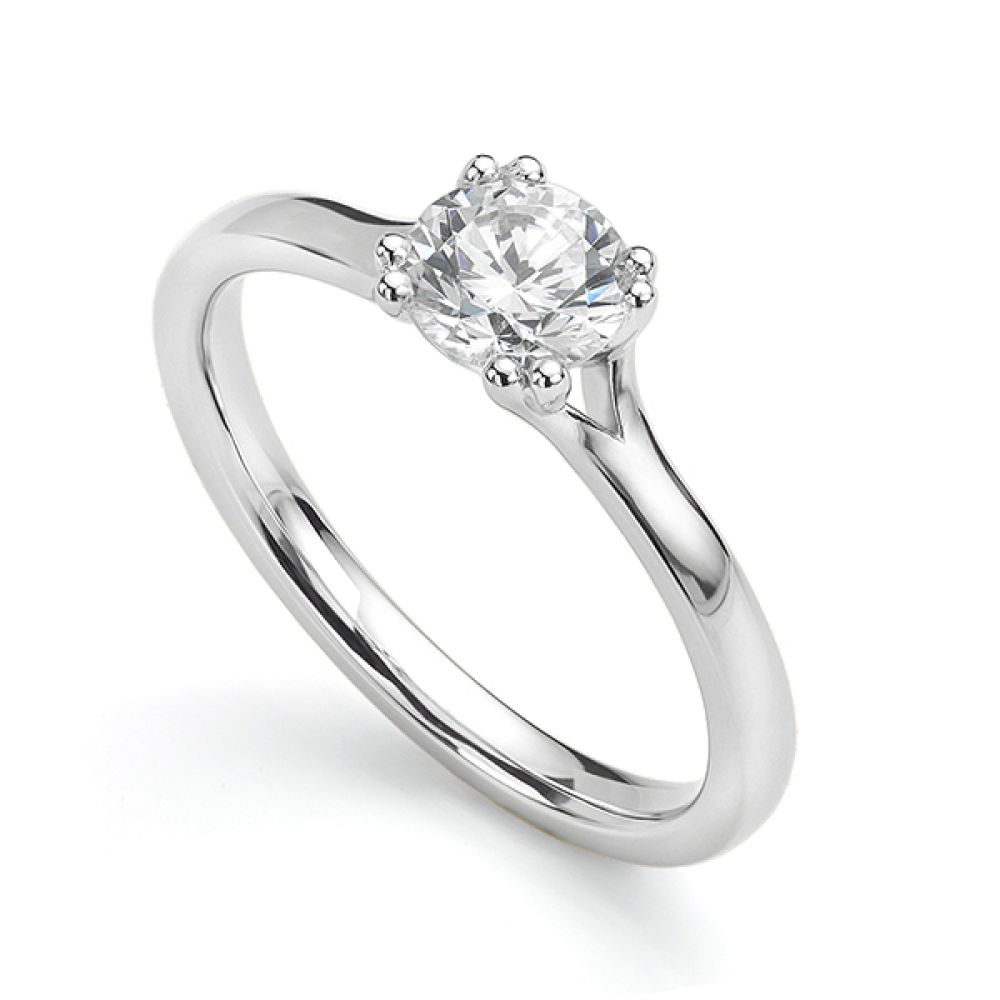 Renoir round solitaire engagement ring with double claws